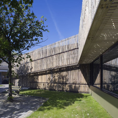 Möhn + Bouman Architects uses wooden fencing to update care centre facade