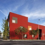 Primary school by C+S Architects features a colourful facade with contrasting window details