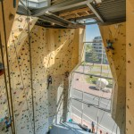 Cave-like apertures frame climbing walls at NL Architects' Spordtgebouw sports centre