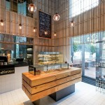 Brass grid structure cages patisserie in Shenzhen by Linehouse