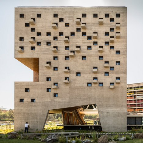 Duque Motta & AA designs punctured concrete volumes for Chilean university faculty