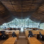 Vo Trong Nghia Architects adds brick and bamboo to Vietnam factory interior