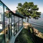 Fall House by Fougeron Architecture steps down a cliff side