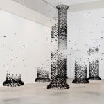 Lumps of charcoal suspended in mid air create outlines of classical architecture and furniture