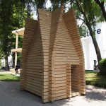 Wooden huts demonstrate regional building techniques at the Finnish Pavilion