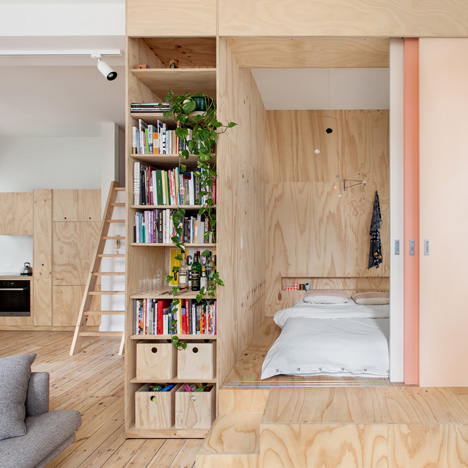 Flinders Lane Apartment by Clare Cousins features a timber box of bedrooms and storage