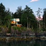 Gambier Island House by MGB cantilevers over a rocky cliff face