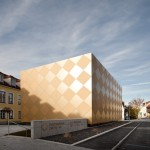 Franz Architekten creates golden chequerboard on Goldstück music hall facade