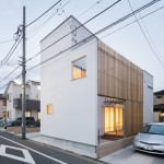Yuji Kimura Design conceals terraces at House K behind a tall wall