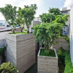 Trees grow on rooftops of Vietnam house by Vo Trong Nghia Architects