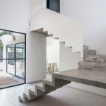 Warm Architects adds cast concrete staircase to Garcia's House in Cancún