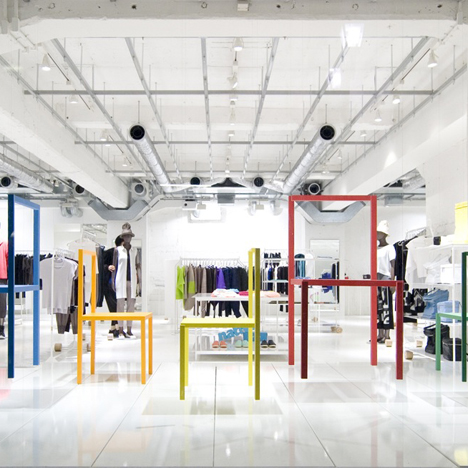 Hanging sticks create illusions of chairs at Issey Miyake boutique in Tokyo