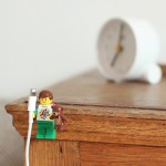 Lego Minifigures hacked with Sugru to create iPhone cable holders
