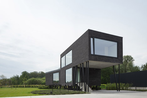 Brick Office Building By Wil Ma And Wastiau Raised On Angled Stilts