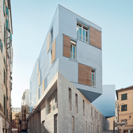 Stone-clad base supports stacked classrooms at PFP Architekten's school in Genoa