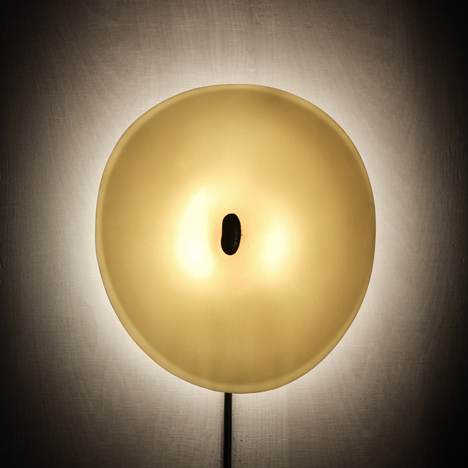 Lumps of lava act as built-in dimmer switches for porcelain lamps by GT2P