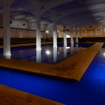 Prada SS15 catwalk by Rem Koolhaas' AMO floats on a blue pool