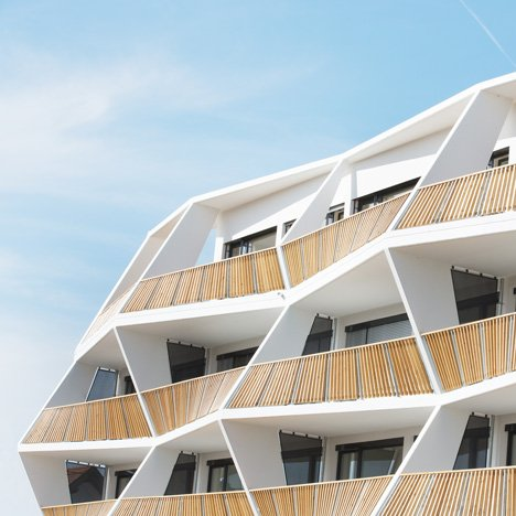 Zig-zagging balconies create sculptural facade for Ragnitzstrasse 36 apartment block