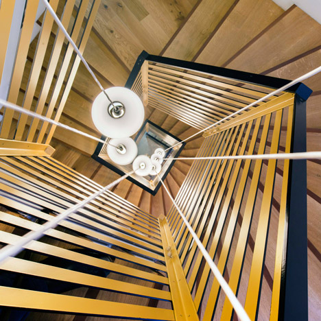 Zoomfactor Architectes updates a city hall with a spiralling staircase