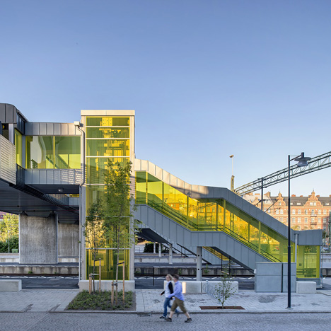 Colourful stairwells zigzag up to meet Metro Arkitekter's Skyttlebron railway bridge