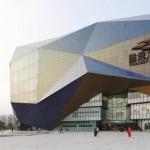 Spark incorporates giant screens into faceted shopping centre facade