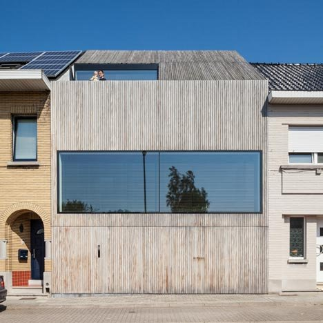 House CM is a contemporary terraced house with a uniform timber facade