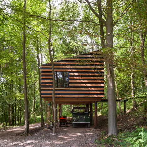 Invisible Studio builds workshop on stilts using trees from surrounding woodland
