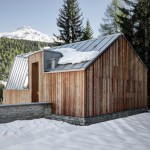 Faceted zinc roof connects uneven wooden gables of Casa FM guest house