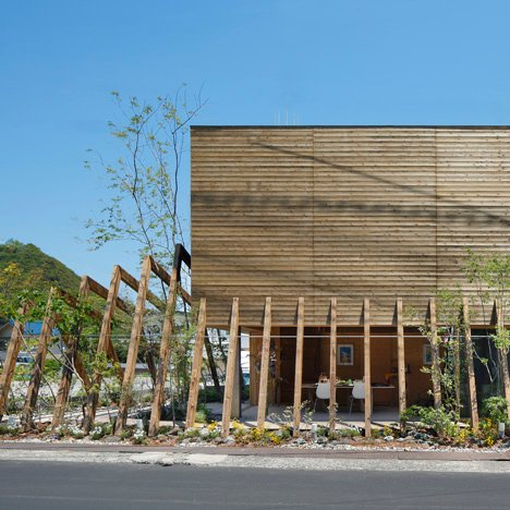 Wooden ribs frame entrance to timber-clad gallery by UID Architects