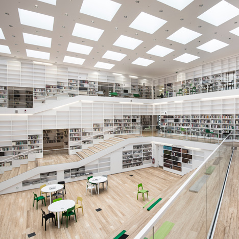 Stairs spiral around interior of adept 39 s dalarna media library for Exterior research and design