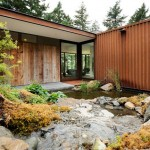 Eagle Ridge Residence by Gary Gladwish frames a rockery and pond