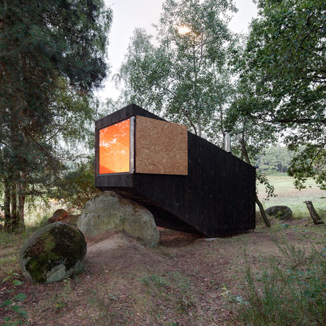 Forest Retreat by Uhlik Architekti rests<br /> on a boulder in a Bohemian wood