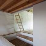 Plain white boxes contain rooms inside Hiroyuki Tanaka's House in Yutenji