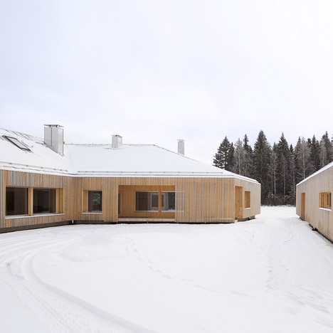 House Riihi by OOPEAA shelters a courtyard from wintery gusts
