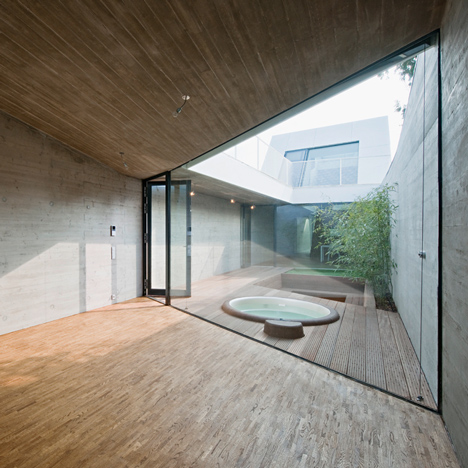Caramel's narrow CJ5 House in Vienna encloses a sunken courtyard garden