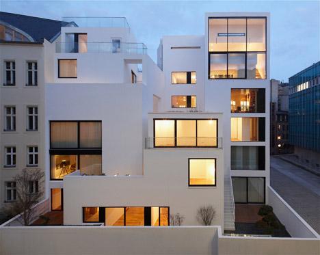 Balconies sit within angular openings at Atelier Zafari's Berlin apartment block