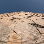 Jagged brick artwork by Boris Tellegen extends over Haarlem housing by Heren 5 Architects