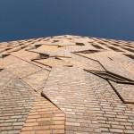 Jagged brick artwork by Boris Tellegen extends over Haarlem housing by Heren 5 Architects