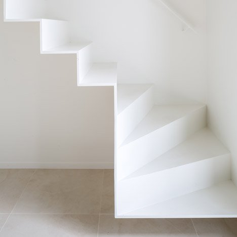 Delicate staircase leads to Isle of Water attic extension by Five AM