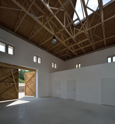 3+1 Architekti converts a stone barn into a woodwork facility with a serrated timber extension