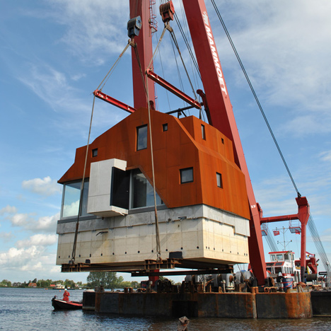 KHM26 house by Jos Blom & Tim Piët was transported to site on the back of a boat