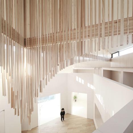 Wooden slats create a sculptural ceiling inside Katsutoshi Sasaki's Koro House