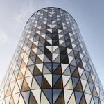Glass triangles animate facade of Wingårdh's auditorium for Karolinska Institutet
