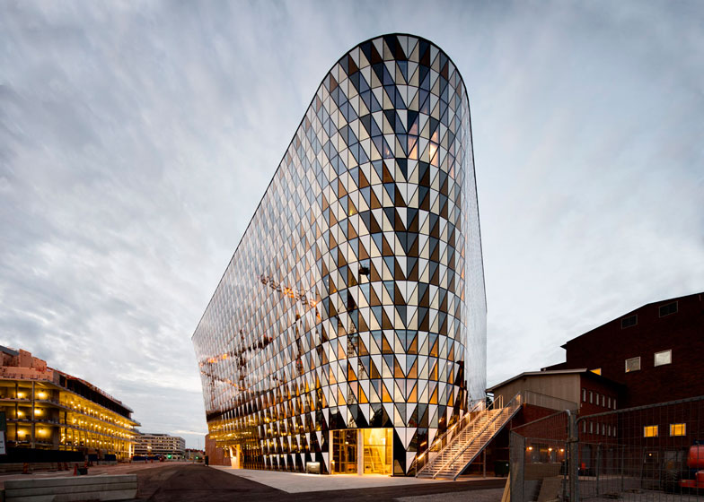 Glass triangles animate facade of Wingårdh's auditorium for Karolinska Institutet
