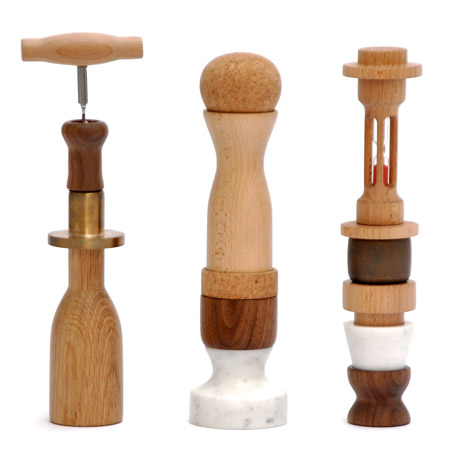 Oliver Richardson stacks kitchen utensils into miniature totem poles