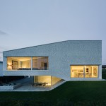 Split-level house by Kit works with the slope of the garden