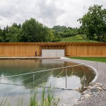 Herzog & de Meuron creates naturally filtered swimming pool in Switzerland