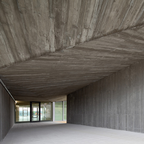 Faceted concrete corridor welcomes children&ltbr /&gt to Taller Básico de Arquitectura's nursery