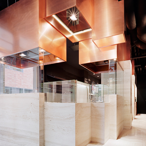 Thomas Kröger Architekt suspends copper cuboids from Berlin restaurant ceiling