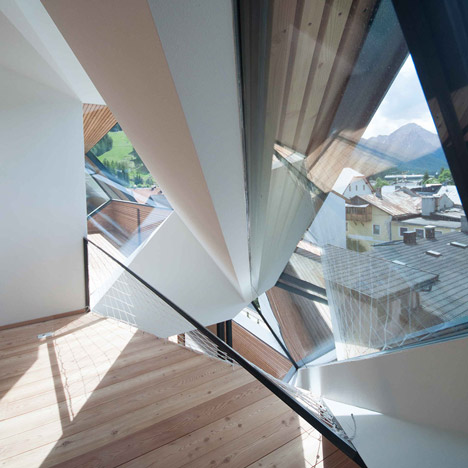 Angular windows create glass shards across Plasma Studio's Schäfer Roofscape